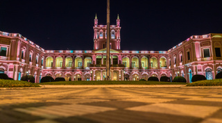 View on illuminated pink presidential palace in Asuncion, Paraguay at night