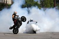 Motorbikes drift white smoke wheel