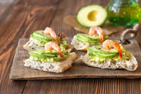 Sandwiches with avocado and shrimps