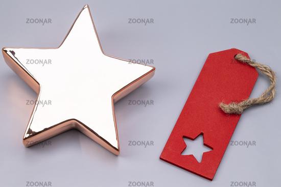 Goldener Stern mit Schild
