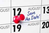 Wall calendar with a red pin - August 12
