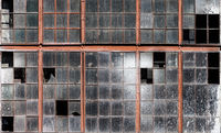 Old building wall with dirty broken windows glass