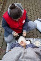 Bulgarian Red Cross Youth Paramedics volunteers head bandage