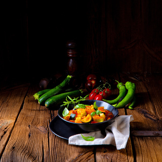 vegetarian ratatouille with fresh vegetables and herbs