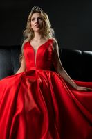 Queen of beauty in red luxurious dress shot