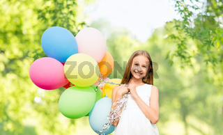 happy girl with balloons over natural background