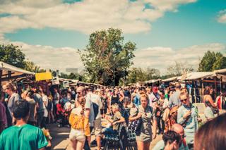 Crowd of  people blurry - walking on flea market (Mauerpark Flohmarkt) on a sunny summer day in Berlin