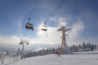 Chairlift with ski pass and sun and halo in winter