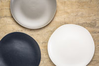 black, gray and white plates on textured paper