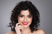 Smiling woman with curls hairstyle