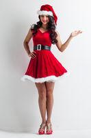 Pin-up Santa girl holding something