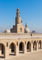 Minaret Ibn Tulun Mosque with helical outer staircase and dome of Amir Sarghatmish mosque, Cairo, Egypt