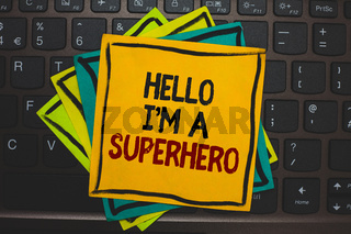 Word writing text Hello I am A Superhero. Business concept for Believing in yourself Self-confidence Introduction Multiple colour sticky border cards computer keyboard text send message.