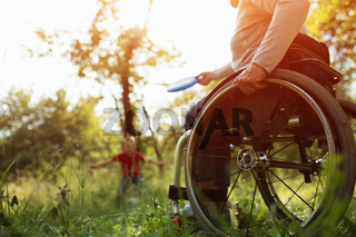 Close-up view on the wheels of a wheelchair. Bright