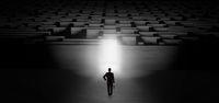 Businessman starting a dark labyrinth challenge