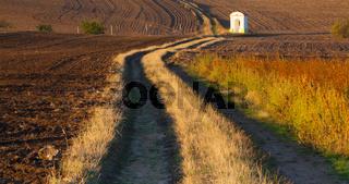 Small chapel in the autumn field. Czech Republic.