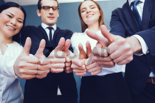 business team showing thumbs up