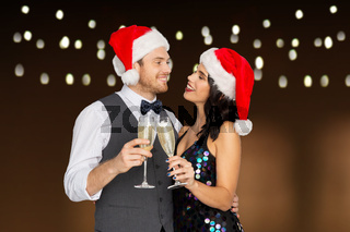 couple with champagne glasses at christmas party