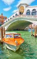 Taxi boat near Rialto bridge in Venice