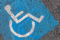 Close - up of disabled parking sign