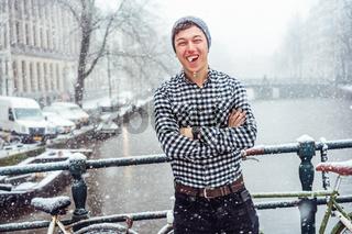 Guy is standing on a bridge