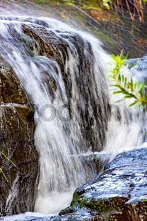 Small waterfall with water running over rocks