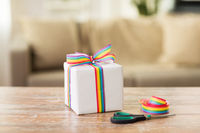 present, gay awareness ribbon and scissors