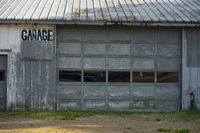 Abandoned Blue Garage Building Hand Written Sign