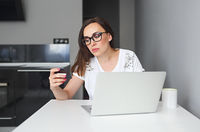 Young woman with computer indoors