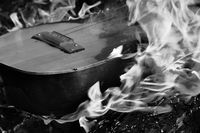 Black and white guitar in flame