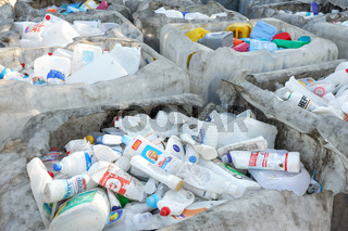 Plastic bottles from cleaning supplies at recycling factory