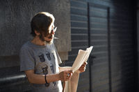 Man reading a newspaper on the street