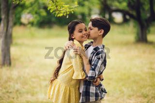 Little boy kissing girl.