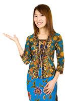 Southeast Asian girl showing something