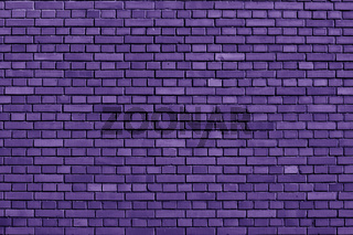 Ultra Violet colored brick wall background