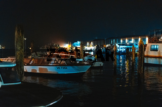 Small boat at night channel