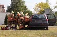 Car crash fire firefighters