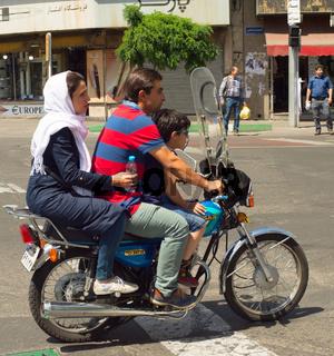 Family motorcycle Tehran road Iran