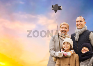 family taking selfie by smartphone outdoors