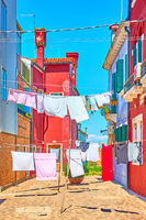 Street with drying linen in Burano