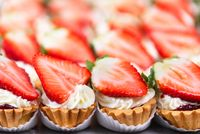 Delicious strawberries cheesecakes tartlets with fresh strawberries.