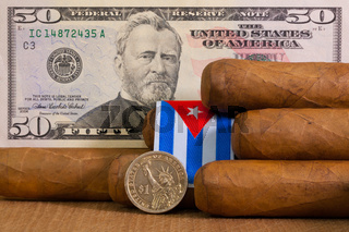 Luxury Cuban cigars with US dollar banknote and coin
