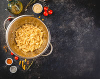 Fusilli pasta in a stainless steel colander