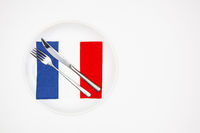 White plate and French flag of colorful napkins.