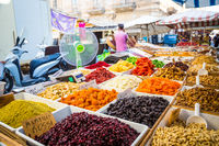 SYRACUSE, ITALY - MAY 04th, 2018: this traditional almonds and pistachios market is one of the most colourful in all Sicily.