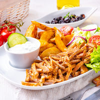 gyros plate it green salad ,olives and potato wedges