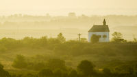 Morning mist at St. Barbara's chapel in Burgenland austria