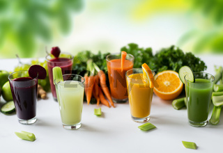 glasses with different fruit or vegetable juices