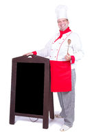 happy chef standing with an blank menu