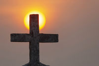 Holy Cross and Sunset at Anjuna Beach, North Goa, India.